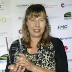 Oamaru veterinarian Merlyn Hay holds the award she received at the inaugural Primary Industries...