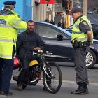 Michael Herzog is pulled over by Dunedin police on his home-made petrol-powered hybrid of motor...