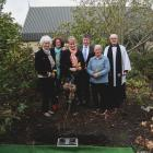 Laying flowers with the buried ashes at Whitestone Funerals' Westview Memorial Garden yesterday...