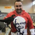 Adam White, of Rangiora, holds his Best Modern Game Bantam-winning bird at the 135th Oamaru...