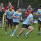 University hooker Ricky Jackson looks to take the ball up against Dunedin in a match at the...