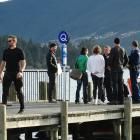 Queenstown police and National Dive Squad members speak to associates of missing Bluff man Matt...