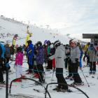 Skiers and snowboarders wait to board a chairlift at Coronet Peak yesterday. PHOTO: GUY WILLIAMS