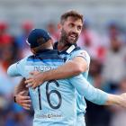 England's Liam Plunkett celebrates with Eoin Morgan after taking the wicket of India's Hardik...
