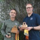 Sean Goodwin (left) and Jarved Allan display the trophies won at the annual Apiculture NZ Honey...