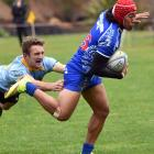 Harbour fullback Lisala Halaleva is tackled by University first five-eighth Mike Williams at...