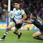 Shaun Johnson breaks the line for the Sharks against the Melbourne Storm last week. Photo: Getty...