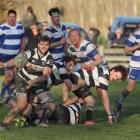 Crescent halfback Josh Cook fires a pass out to his backs in his team's Southern Region...