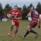 Clutha No8 Kerrod Baldwin prepares himself for the tackle from Clutha Valley wing Todd McCammon...