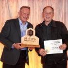 Allen McCaw receives his supreme award from sponsor Kevin Powell (left), of Kiwi Labels. Photo:...