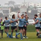 University players celebrate after winning their semifinal against Harbour at the University of...