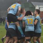 University players celebrate their win over Harbour in the semifinal at the University Oval on...