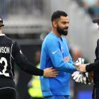 Indian captain Virat Kohli shakes hands after last night's semifinal against the Black Caps....