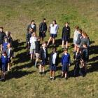 Pupils and staff of Mt Aspiring College, Wanaka, form the number 1000, signifying the size of the...