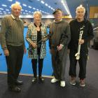 Rotary Club of Dunedin South president Jo Morshuis inspects bowling arms in Dunedin Lawn Bowls...