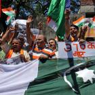 Supporters of Shiv Sena, a Hindu hardline group, shout slogans during a protest against Pakistan,...