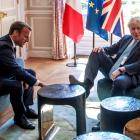 Boris Johnson was quick to make himself at home in Emmanuel Macron's gilded palace, putting his...