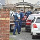 Armed police search a car in Clyde St, Dunedin, yesterday, part of a major national anti...