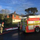 Firefighters at the scene of a blaze in Halfway Bush this morning. Photo: Gregor Richardson