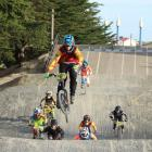 Southland BMX Club member Fairlane McEwan-Geange (13)  races on the track at Elizabeth Park....