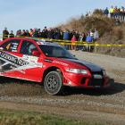 Dean Bond, of Balclutha, slides his Mitsubishi Evo 6.5 through the Romahapa corner during the...