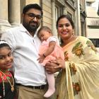 Indian-born Bijin Paul, his wife Princy Zacharias and their children Miya (left) and Moria Bijin...