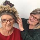 Heather McPherson (left) showcases a beanie with the help of Jan Hawkins ahead of this year's...