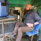 Daniel Wheeler hard at work scanning ewes. Photo: Maggie Croft