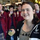 World junior swimming champion Erika Fairweather is greeted by her Kavanagh College classmates at...