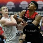 Finn Delany and Rui Hachimura battle for a rebound during the Tall Blacks' match against Japan...