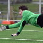 Otago University goalkeeper Stewart Catto attempts to save a Coastal Spirit shot during a...