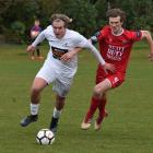 Caversham's Andrew Ridden (right) challenges Bay Olympic's Callum McNeill during their Chatham...