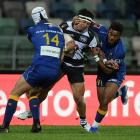 Otago's Henry Purdy (left) and Vilimoni Koroi tackle Jonah Lowe, of Hawke's Bay, during the Mitre...