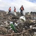 Millions of pieces of plastic from the landfill were tangled in the riverbed and forest, and were...