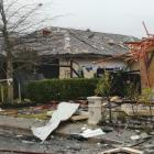 Several homes in Northwood, near the site of a gas explosion which completely destroyed a house,...