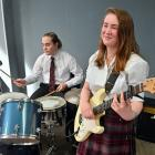 Logan Park High School musicians Mathew Schack and Melicen Barber rehearse one of their latest...