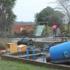 Workers clean the Longbush Rural Kindergarten which was closed last week because of run-off from...