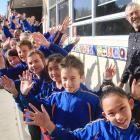Celebrating the success of Papakaio School are Room 5 - year 5 and 6 pupils - and principal Gary...