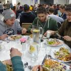 Wanaka-based ski workers from around the world enjoy the free fortnightly meal at the St Andrew's...