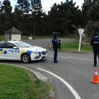 Armed police near the cordon at the Glenavy rest area. Photo: Daniel Birchfield