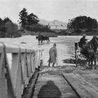 The road at Outram submerged by floodwaters. - Otago Witness, 29.8.1919.