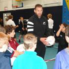 All Blacks captain Kieran Read organises a skills session with primary school pupils at Wakatipu...