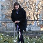 University of Otago vice-chancellor Harlene Hayne (top) plants an Otago University rose. PHOTOS:...