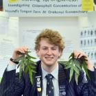 King's High School pupil Aaron Hewson with some of the Hound's Tongue Ferns he studied for his...