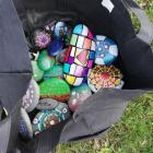 Painted rocks were found in Rolleston's Parekura Reserve as part of an initiative to bring the...