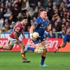 Otago's Dylan Nel runs away from Southland's Moses Faletolu to score during the Ranfurly Shield...