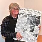 Suzanne Emslie holds a copy of the front page of the Otago Daily Times from the day after the...