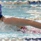 Queenstown's Jemima Barr (13) races in the 100m butterfly during the South Island swimming...