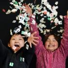 Broad Bay School pupils Tenyu Xu (6) and Lucia Sharma (7) show some of the bread bag tags they...