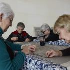 Otago Embroiderers' Guild members Jan Letts (front left) and Jeanette Trotman continue work on a...